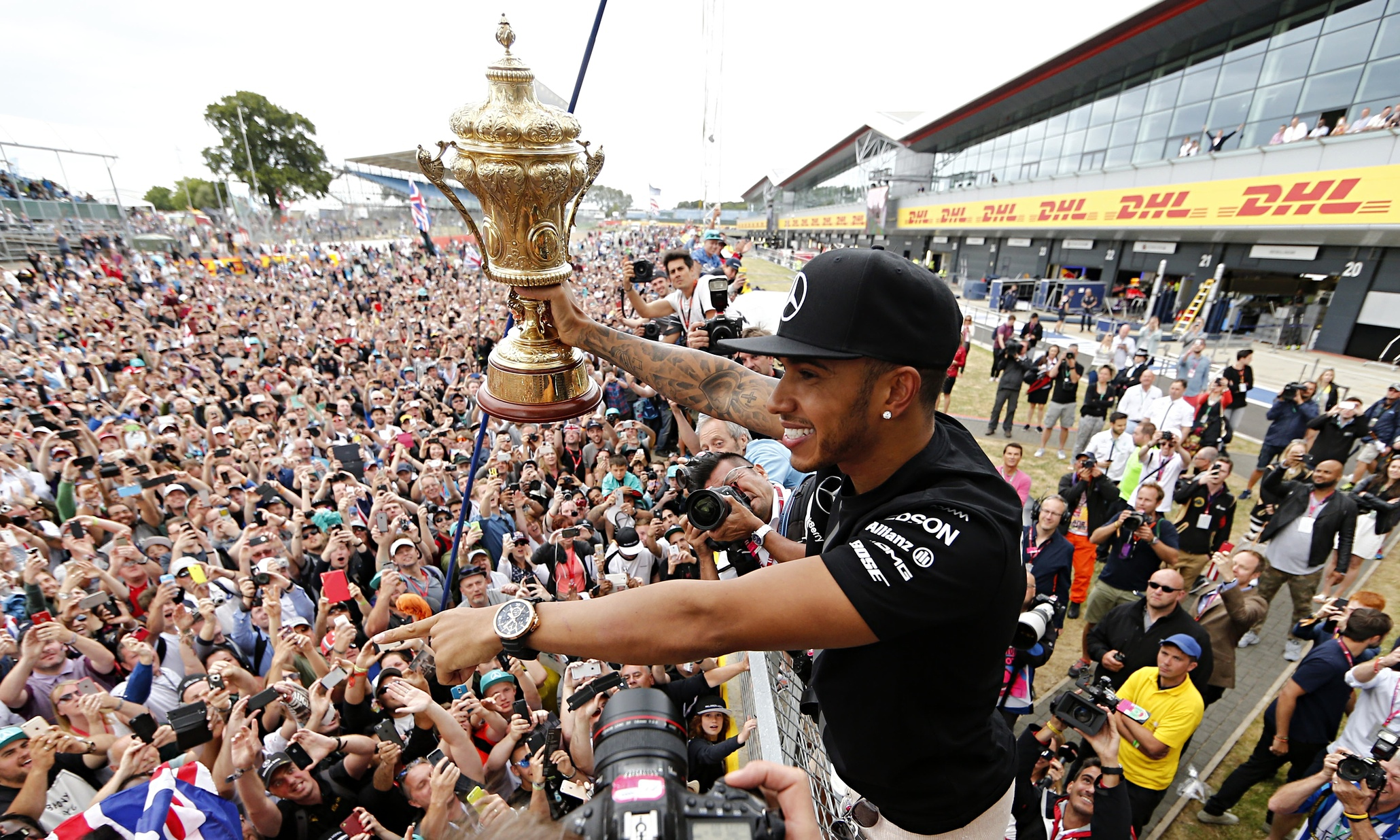 Lewis Hamilton shares a moment with the assembled masses at Silverstone after admitting he struggled